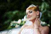 Luxurious bride with a haughty look in a wedding dress — Stock Photo
