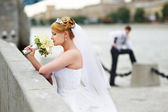 Groom adn bride for walk on embankment river — Stock Photo