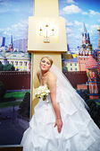 Happy bride in a wedding dress against Moscow Kremlin — Stock Photo