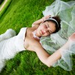 Stock Photo: Happy bride are on grass