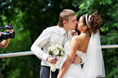 Kiss the bride and groom at wedding walk — Stock Photo