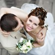 Happy bride and groom at wedding walk — Stock Photo #10830973