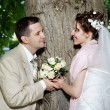 Happy bride and groom at wedding walk — Stock Photo #10831277