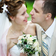 Happy bride and groom at wedding walk — Stock Photo