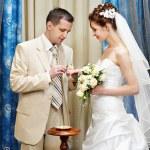 Groom wears a wedding ring a happy bride — Stock Photo
