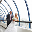 Bride and groom in interiors of Bridge Business Center — Stock Photo