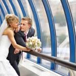 Bride and groom in interiors of Bridge Business Center — Stock Photo