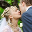 Romantic kiss at wedding walk — Stock Photo
