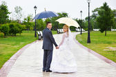 Happy Bride and groom at wedding walk in park — Stock Photo