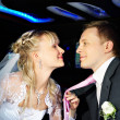 Happy bride and groom in wedding limousine — Stock Photo #10852114