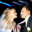 Happy bride and groom in wedding limousine — Stock Photo