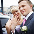 Happy bride and groom with wedding rings on hands — Stock Photo #10852232