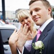 Stock Photo: Happy bride and groom with wedding rings on hands