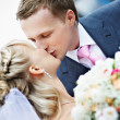 Kiss bride and groom at wedding — Stock Photo #10852540