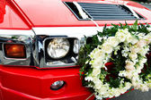 Red wedding limousine, decorated with flowers — Stock Photo