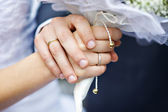 Hands with wedding rings newlyweds — Photo