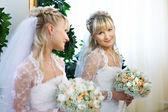 Happy bride in mirror — Stock Photo