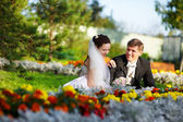 Happy bride and groom at wedding walk — Stock Photo