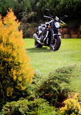 Motorcycle on the meadow — Stock Photo