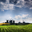 Stock Photo: Atomic power station and field