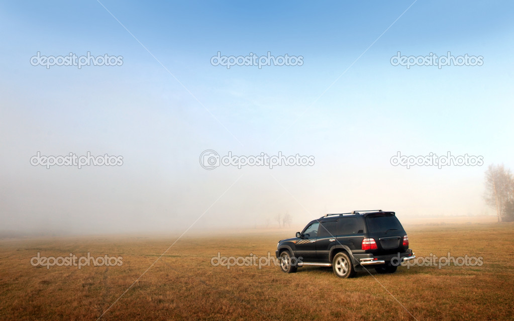 Car in the field and haze  — Stock Photo #11241161