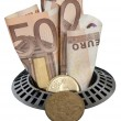 Stock Photo: Money down drain
