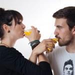 Romantic couple drinking orange juice — Stock Photo