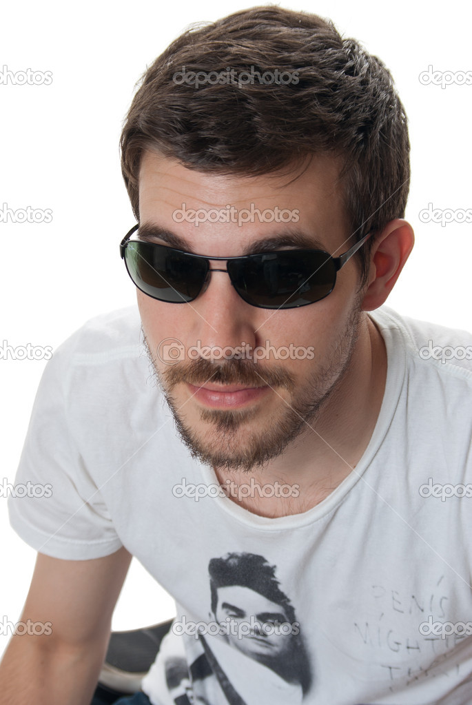 Portrait of a handsome young man with a beard and moustache on a white studio background — Stock Photo #10771840