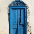 Blue door in tunisia - Stock Photo