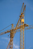 Two construction cranes with sky as a background — Стоковое фото
