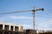 Construction crane working on a new building — Stock Photo