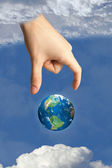 Earth in heaven and the hand of god — Stock Photo