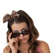 Attractive young female wearing sunglasses — Stock Photo