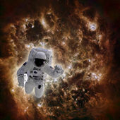 Astronaut in space with galaxy in background — Stock Photo