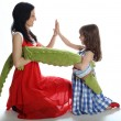Mother and the daughter play with a toy crocodile — Stock Photo