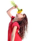Girl smelling dandelion — Stock Photo