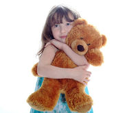 Little girl taking teddy bear — Stock Photo
