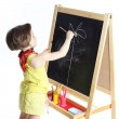 The girl draws on a board — Stock Photo