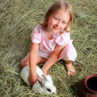 Girl with rabbit — Stockfoto