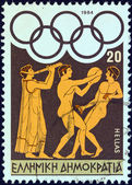 "GREECE - CIRCA 1984: A stamp printed in Greece from the ""Olympic Games, Los Angeles"" issue shows flute player, discus thrower and long jumper, circa 1984. — Stock Photo"