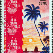 SAMOA - CIRCA 1972: A stamp printed in Samoa issued for the 250th anniversary of Jacob Roggeveen Pacific voyage and discovery of Samoa in June 1722 shows two sailing ships at sunset, circa 1972. — Stock Photo