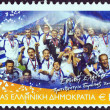 "GREECE - CIRCA 2004: A stamp printed in Greece from the ""Greece, European football champion 2004"" issue shows the Greek football national team, circa 2004. — Stock Photo"
