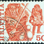 "SWITZERLAND - CIRCA 1977: A stamp printed in Switzerland from the ""Regional Folk Customs"" issue shows Archetringele, Laupen, circa 1977. — Stock Photo #10940682"