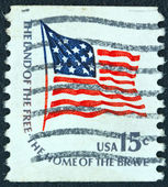 "USA - CIRCA 1975: A stamp printed in USA from the ""Americana"" issue shows the Fort McHenry flag and the inscription ""The Land of the Free-the Home of the Brave"", circa 1975. — Stock Photo"
