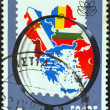"""GREECE - CIRCA 1979: A stamp printed in Greece from the """"Balkanfila '79 stamp exhibition"""" issue shows magnifying glass and map of Balkan countries, circa 1979. — Stock Photo"""