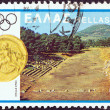 "GREECE - CIRCA 1980: A stamp printed in Greece from the ""Olympic Games, Moscow. Designs showing Greek stadia"" issue shows ancient Epidaurus and coin of Olympia, circa 1980. — Stock Photo"