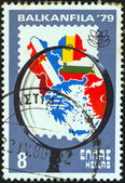 "GREECE - CIRCA 1979: A stamp printed in Greece from the ""Balkanfila '79 stamp exhibition"" issue shows magnifying glass and map of Balkan countries, circa 1979. — Stock Photo"
