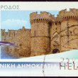 "GREECE - CIRCA 2006: A stamp printed in Greece from the ""Island views"" issue shows the castle of Rhodes island, circa 2006. - Stock Photo"
