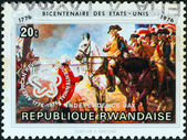 RWANDA - CIRCA 1976: A stamp printed in Rwanda issued for the bicentenary of American Revolution shows the surrender at Yorktown, circa 1976. — Stock Photo