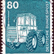 "GERMANY - CIRCA 1975: A stamp printed in Germany from the ""Industry and Technology"" issue shows a farm tractor, circa 1975. - Stock Photo"
